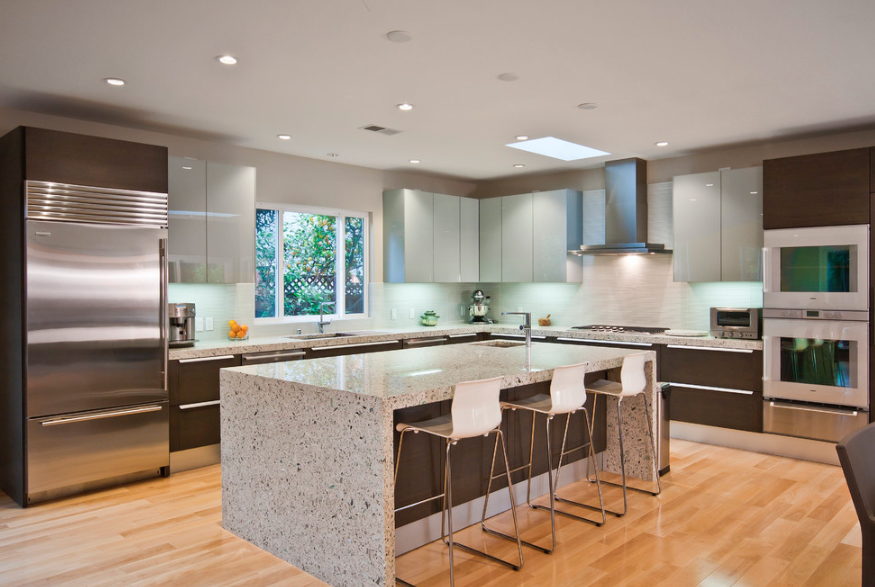 gray kitchen with yellow cabinets