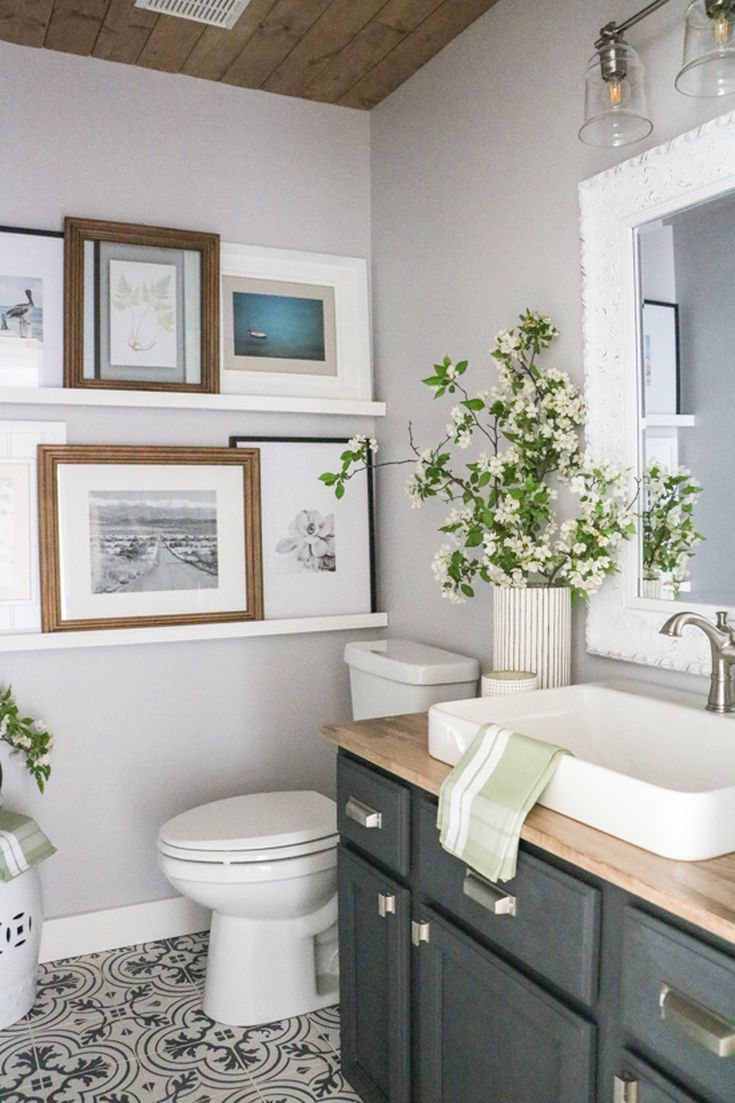 Bathroom with Many Paintings