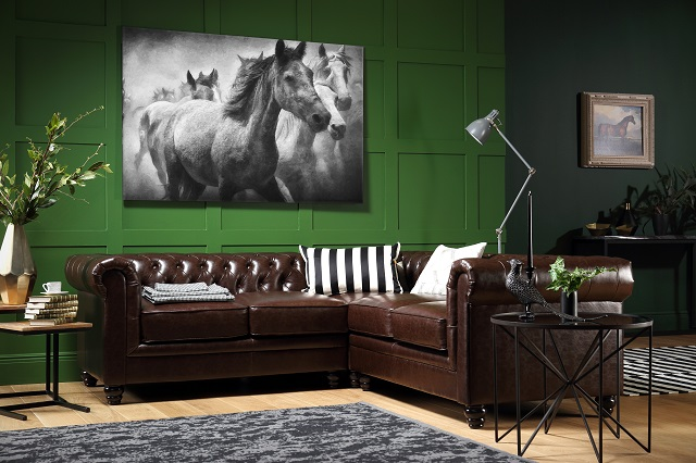 living room with dark green wall accent