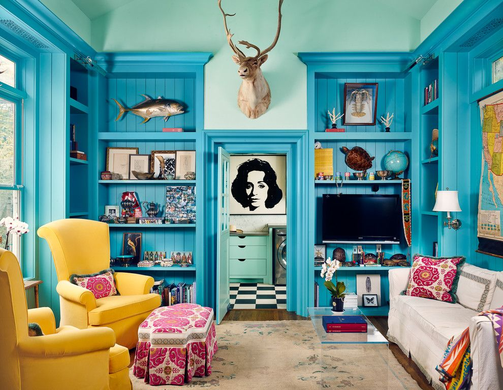 living room in teal and a pairs of yellow chairs