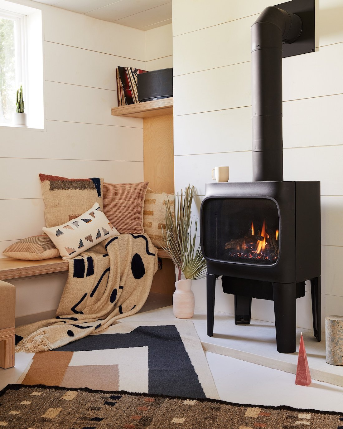small living room with standalone fireplace